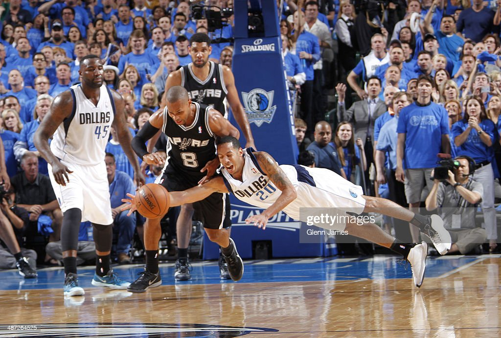Devin Harris #20 of the Dallas Mavericks dives for a loose ball against the San Antonio Spurs in Game Four of the Western Conference Quarterfinals during the 2014 NBA Playoffs on April 28, 2014 at the American Airlines Center in Dallas, Texas.