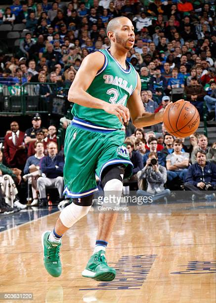 Devin Harris of the Dallas Mavericks dribbles the ball against the Milwaukee Bucks on December 28 2015 at the American Airlines Center in Dallas...