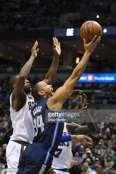 Devin Harris of the Dallas Mavericks drives to the basket against Khris Middleton of the Milwaukee Bucks during the second half of a game at the...