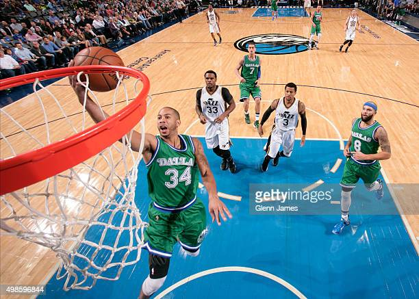 Devin Harris of the Dallas Mavericks drives to the basket against the Utah Jazz on November 20 2015 at the American Airlines Center in Dallas Texas...
