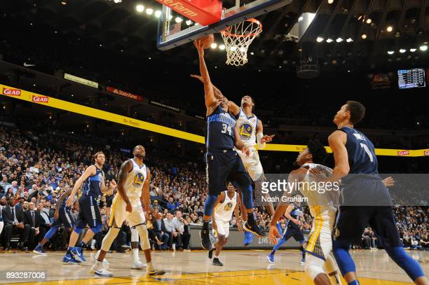 Devin Harris of the Dallas Mavericks goes to the basket against the Golden State Warriors on December 14 2017 at ORACLE Arena in Oakland California...