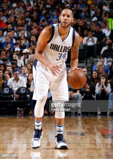Devin Harris of the Dallas Mavericks handles the ball against the Phoenix Suns during the game on March 11 2017 at the American Airlines Center in...