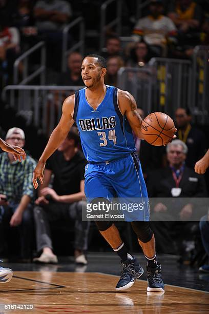 Devin Harris of the Dallas Mavericks handles the ball during a preseason game against the Denver Nuggets on October 21 2016 at the Pepsi Center in...