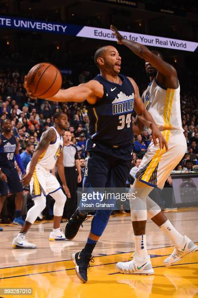 Devin Harris of the Dallas Mavericks looks to pass against the Golden State Warriors on December 14 2017 at ORACLE Arena in Oakland California NOTE...