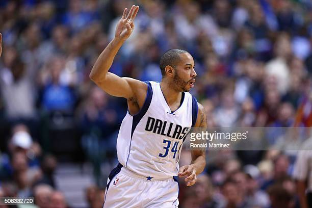 Devin Harris of the Dallas Mavericks reacts after a threepoint shot against the Dallas Mavericks in the first half at American Airlines Center on...