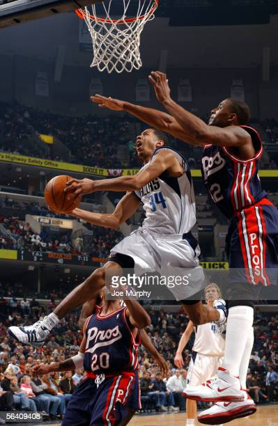 Devin Harris of the Dallas Mavericks shoots a layup past Lorenzen Wright of the Memphis Grizzlies on December 9, 2005 at FedexForum in Memphis,...