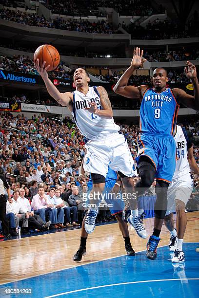 Devin Harris of the Dallas Mavericks shoots against Serge Ibaka of the Oklahoma City Thunder on March 25 2014 at the American Airlines Center in...