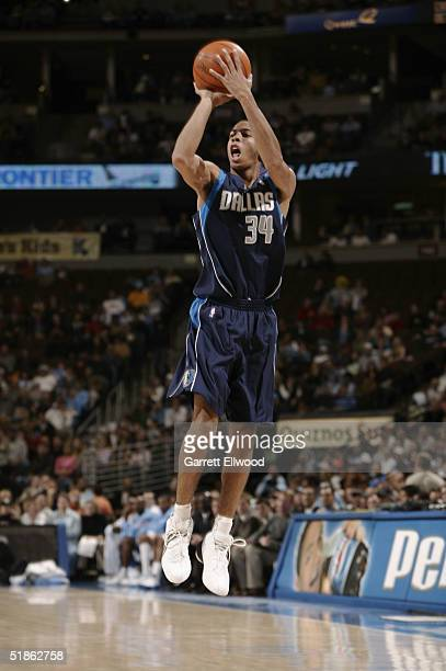 Devin Harris of the Dallas Mavericks shoots against the Denver Nuggets during the game at Pepsi Center on November 21 2004 in Denver Colorado The...