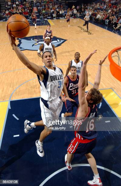 Devin Harris of the Dallas Mavericks shoots over Pau Gasol of the Memphis Grizzlies on December 9, 2005 at FedexForum in Memphis, Tennessee. NOTE TO...