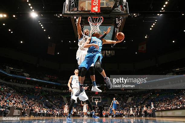 Devin Harris of the Dallas Mavericks shoots the ball against Adreian Payne of the Minnesota Timberwolves on January 10 2016 at Target Center in...