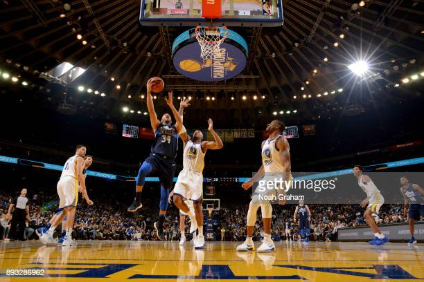 Devin Harris of the Dallas Mavericks shoots the ball against the Golden State Warriors on December 14 2017 at ORACLE Arena in Oakland California NOTE...