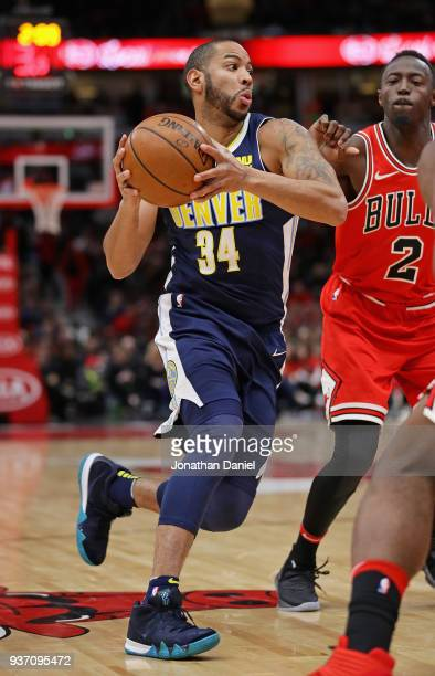Devin Harris of the Denver Nuggets drives past Jerian Grant of the Chicago Bulls at the United Center on March 21 2018 in Chicago Illinois The...