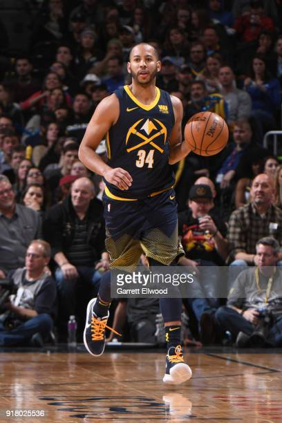 Devin Harris of the Denver Nuggets handles the ball against the San Antonio Spurs on February 13 2018 at the Pepsi Center in Denver Colorado NOTE TO...