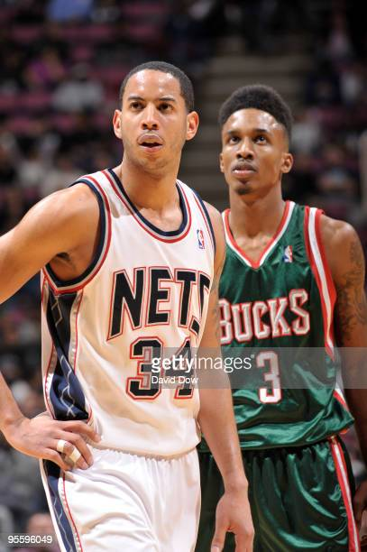 Devin Harris of the New Jersey Nets and Brandon Jennings of the Milwaukee Bucks show emotion during the game on January 5 2010 at the Izod Center in...