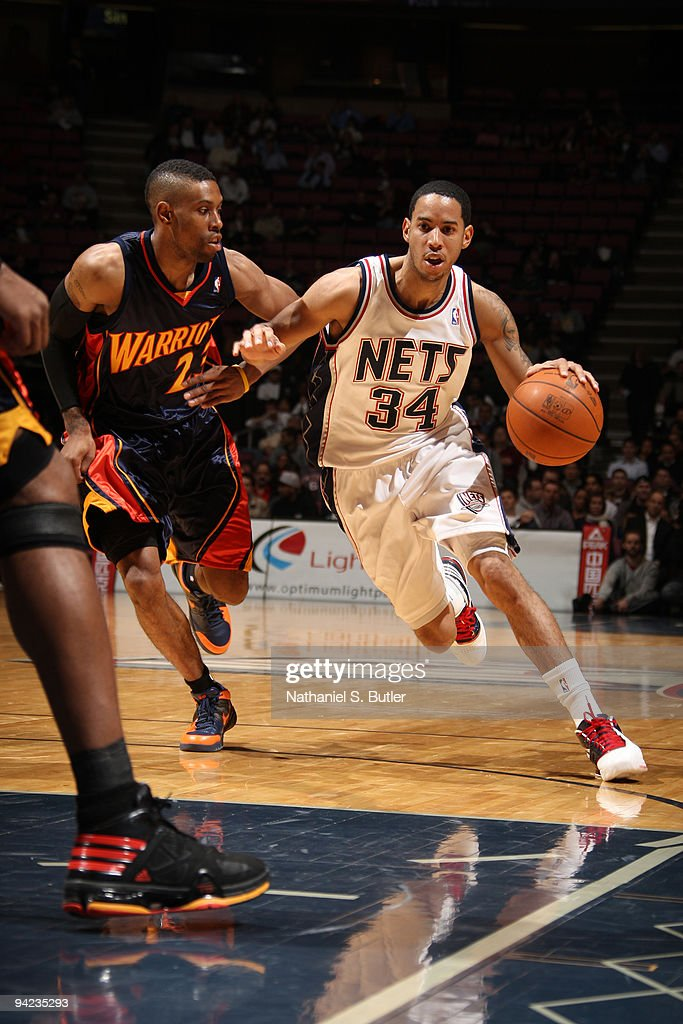 quality design 25029 d873f Devin Harris of the New Jersey Nets drives against C.J. ...