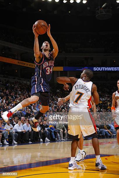 Devin Harris of the New Jersey Nets goes up for a shot over Kelenna Azubuike of the Golden State Warriors on March 11 2009 at Oracle Arena in Oakland...