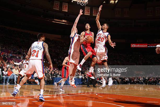 Devin Harris of the New Jersey Nets shoots against David Lee and Jared Jeffries of the New York Knicks on December 6 2009 at Madison Square Garden in...