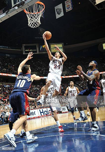 Devin Harris of the New Jersey Nets shoots against Wally Szczerbiak of the Cleveland Cavaliers on March 12 2008 at the Izod Center in East Rutherford...