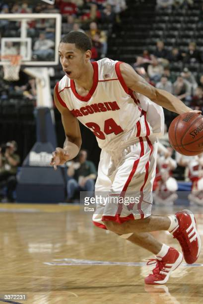 Devin Harris of the University of Wisconsin Badgers drives against the University of Minnesota Golden Gophers during the Big Ten Tournament at the...