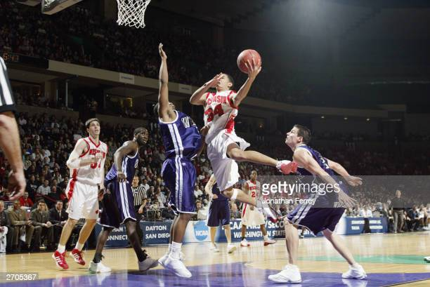 Devin Harris of the University of Wisconsin Badgers drives to the hoop during the NCAA Tournament 1st round game against the Weber State University...
