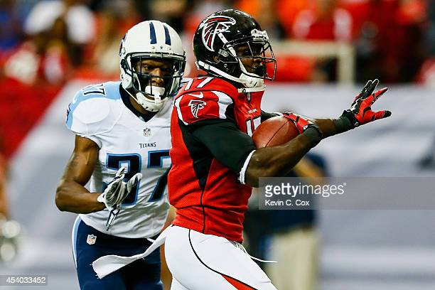 Devin Hester of the Atlanta Falcons runs past Tommie Campbell of the Tennessee Titans after a catch to score a touchdown in the first half of a...