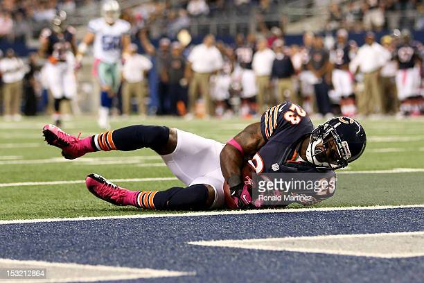 Devin Hester of the Chicago Bears catches a 34-yard touchdown reception in the third quarter against the Dallas Cowboys at Cowboys Stadium on October...