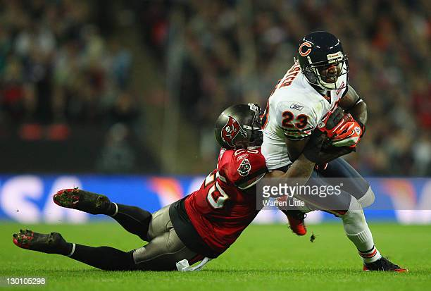 Devin Hester of the Chicago Bears is tackled by Aqib Talib of the Tampa Bay Buccaneers during the NFL International Series match between Chicago...