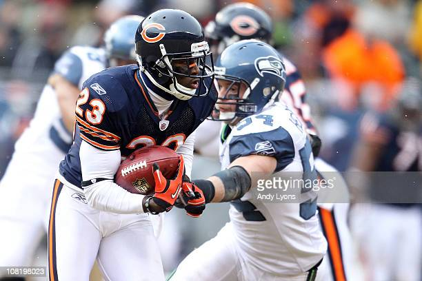 Devin Hester of the Chicago Bears returns a kick against the Seattle Seahawks in the 2011 NFC divisional playoff game at Soldier Field on January 16...