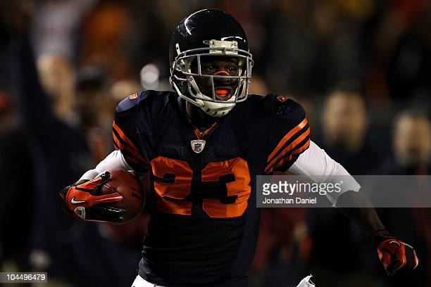 Devin Hester of the Chicago Bears returns a punt 62yards for a touchdown in the fourth quarter against the Green Bay Packers at Soldier Field on...
