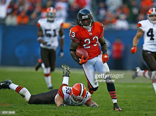 Devin Hester of the Chicago Bears returns a punt as Jason Trusnik of the Cleveland Browns misses a tackle at Soldier Field on November 1 2009 in...