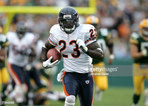 Devin Hester of the Chicago Bears runs back a punt 84 yards for a touchdown against the Green Bay Packers on September 10 2006 at Lambeau Field in...