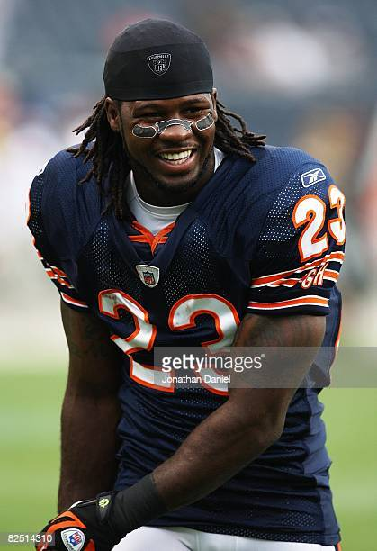 Devin Hester of the Chicago Bears smiles at teammates during warmups before a game against the San Francisco 49ers on August 21 2008 at Soldier Field...