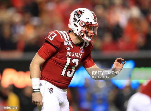 Devin Leary of the North Carolina State Wolfpack calls a play against the Clemson Tigers during their game at CarterFinley Stadium on November 09...