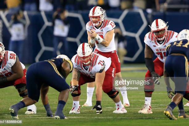 Devin Leary of the North Carolina State Wolfpack calls out the snap count during the college football game between the North Carolina State Wolfpack...