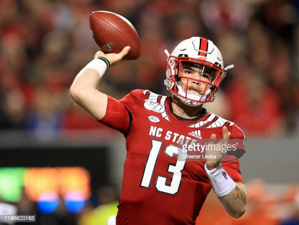 Devin Leary of the North Carolina State Wolfpack drops back to pass against the Clemson Tigers during their game at CarterFinley Stadium on November...
