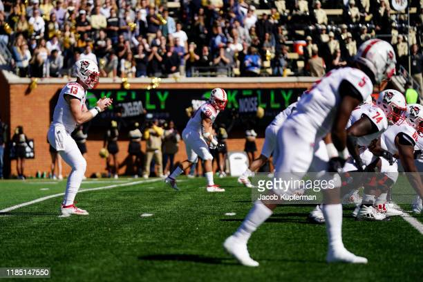 Devin Leary of the North Carolina State Wolfpack in the first half during their game against the Wake Forest Demon Deacons at BBT Field on November...