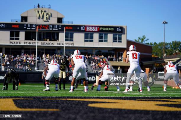 Devin Leary of the North Carolina State Wolfpack in the second half during their game against the Wake Forest Demon Deacons at BBT Field on November...