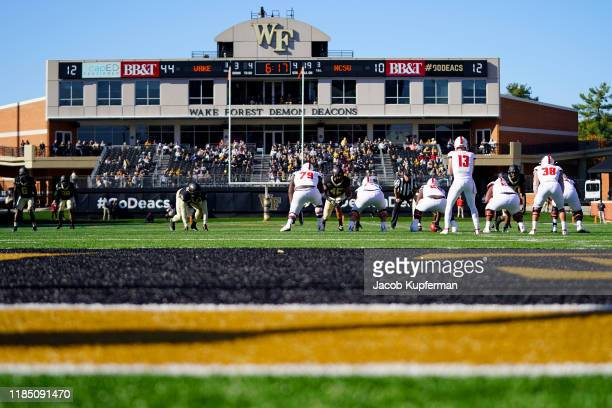 Devin Leary of the North Carolina State Wolfpack readies for the snap in the fourth quarter during their game against the Wake Forest Demon Deacons...
