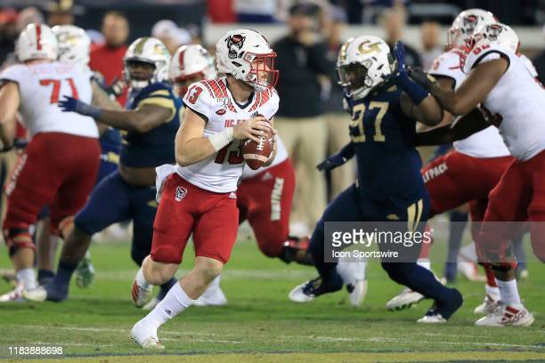 Devin Leary of the North Carolina State Wolfpack rolls out during the college football game between the North Carolina State Wolfpack and the Georgia...