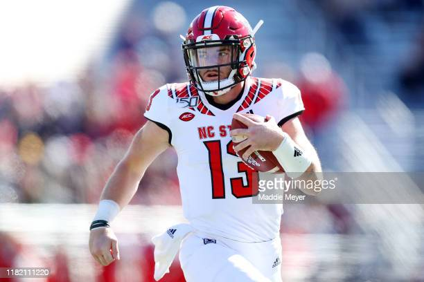 Devin Leary of the North Carolina State Wolfpack runs the ball during the first half of the game between the Boston College Eagles and the North...