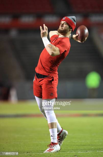 Devin Leary of the North Carolina State Wolfpack warms up before their game against the Clemson Tigers at CarterFinley Stadium on November 09 2019 in...
