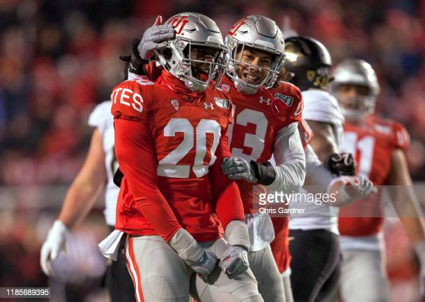 Devin Lloyd of the Utah Utes is congratulated by teammate Francis Bernard after sacking Steven Montez of the Colorado Buffaloes during the second...