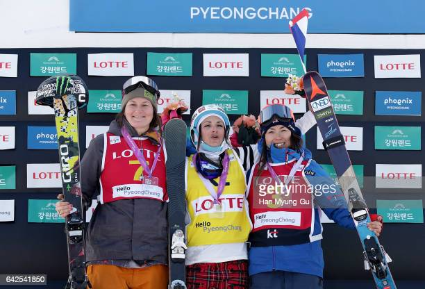 Devin Logan from USA in second place Marie Martinod from France in first place and Ayana Onozuka from Japan in third place in the FIS Freestyle Ski...
