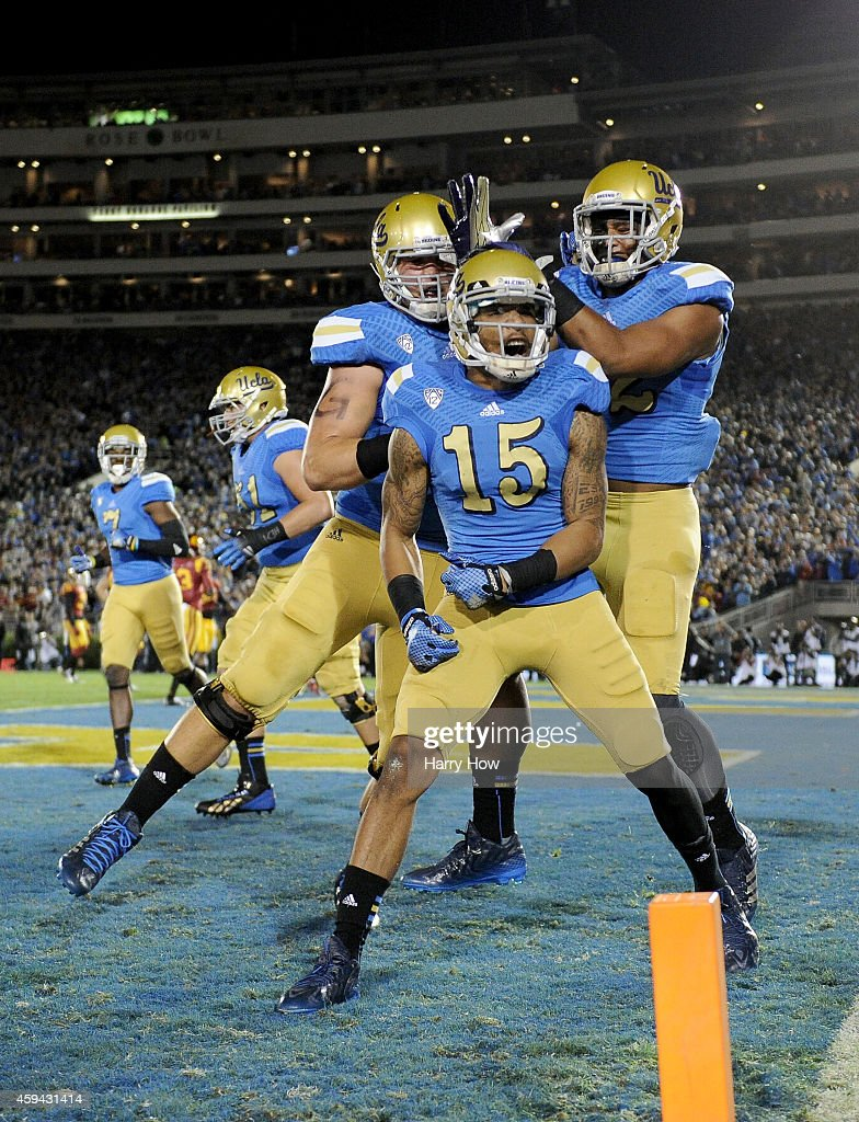 Devin Lucien #15 of the UCLA Bruins celebrates his touchdown to tie the score 7-7 against the USC Trojans during the first quarter at the Rose Bowl on November 22, 2014 in Pasadena, California.