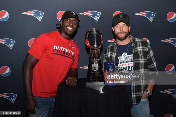Devin McCourty and Chris Lane with the Super Bowl LIII Lombardi Trophy and Pepsi's Limited Edition Patriots Laces Shaped Can during Pepsis...