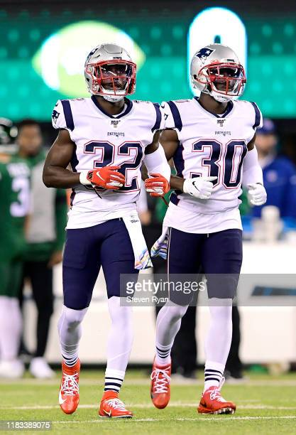 Devin McCourty and Jason McCourty of the New England Patriots looks on against the New York Jets at MetLife Stadium on October 21 2019 in East...
