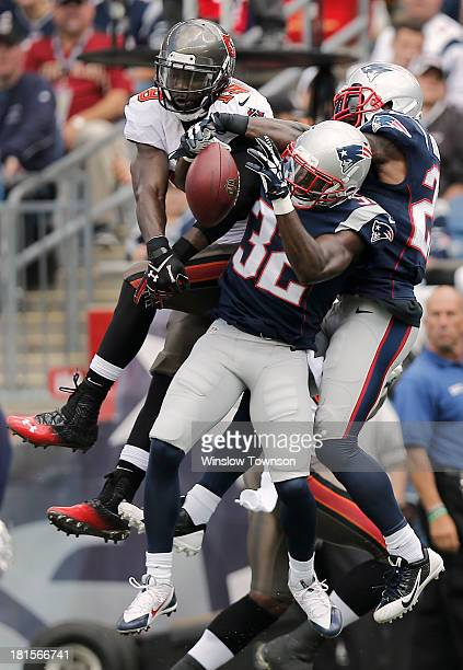 Devin McCourty of the New England Patriots and Aqib Talib of the New England Patriots break up a pass intended for Mike Williams of the Tampa Bay...