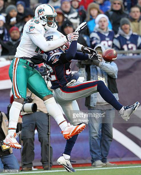 Devin McCourty of the New England Patriots breaks up a pass intended for Brandon Marshall of the Miami Dolphins in the first half at Gillette Stadium...