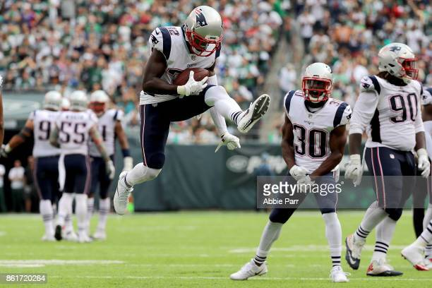 Devin McCourty of the New England Patriots celebrates after intercepting a pass from Josh McCown of the New York Jets in the third quarter during...