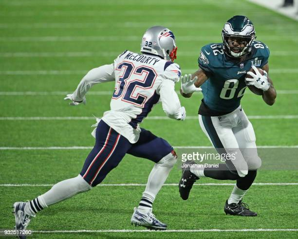 Devin McCourty of the New England Patriots chases Torrey Smith of the Philadelphia Eagles during Super Bowl Lll at US Bank Stadium on February 4 2018...